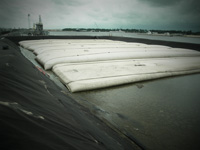 Wastewater treatment system construction and dredge solids dewatering